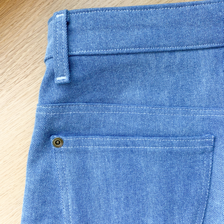 Close up of back pocket and side belt loop